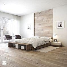 Sypialnia styl minimalistyczny - drewno na ścianie, niskie łóżko, biel