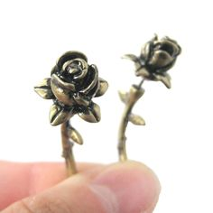- Details - Sizing - Shipping A pair of floral shaped stud earrings in brass! These rose shaped earrings are made to look like fake gauges, they open up and are worn like stud earrings but look like t