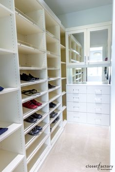 Perfect for any shoe fanatic, this pristine white melamine walk-in uses Lucite as toe stoppers to hold shoes in place as well as handles for the polished cabinets and drawers. Learn more here: Walk In Closet Design, Closet Designs, Custom Closets, Master Closet, Closet Space, Closet Organization, Dressing Room, Building A House, Drawers