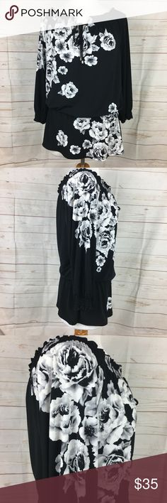 """White House Black Market Floral Top Size M White House Black Market Tunic Top Bohemian, peasant, elastic cuffs, elastic waistline, 3/4 sleeves, elastic banding around tie neckline. Colors: Black, white, gray. No holes, stains, pulls, piling. Clean and from non smoking home.  Material: Polyester & Spandex Bust: 38"""" Waist: 30"""" Hip: 39"""" Arm: from underarm to edge of cuff 15"""" Length: 28"""" White House Black Market Tops"""