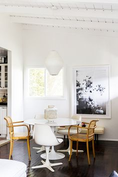 Round tulip table and chair in the relaxed and light-filled L.A home of Victoria from SF Girl By Bay. Laure Joliet.