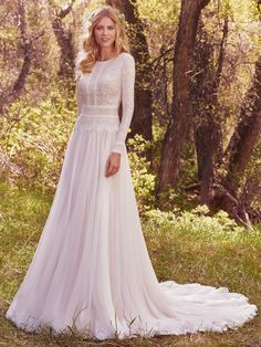 Long lace sleeves paired with a flowing chiffon skirt complete this understated yet elegant gown.