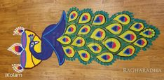 A beautiful peacock rangoli for Diwali, by RaghaRadha -- iKolam.com.  Visit the site to enjoy the same rangoli decorated with lit diyas! Absoulutely divine! Peacock Rangoli, Rangoli Designs, World Cultures, Diwali, Folk Art, Beach Mat, Cool Designs, Outdoor Blanket, Kids Rugs