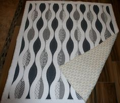 This quilt pattern is called Urban Pods and uses the Quick Curve Ruler.  I used all grey and white fabric with a backing that had pale yellow.