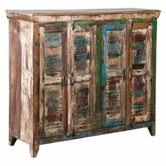 """Reclaimed mango wood cupboard with a distressed multicolor finish and 4 louvered doors that open to reveal interior shelving.    Product: CupboardConstruction Material: Reclaimed mango woodColor: MultiFeatures:  Functional shelf insideRustic design Dimensions: 41"""" H x 49"""" W x 16"""" D"""