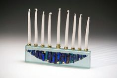 Contemporary menorah made with fused glass and metal