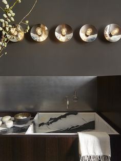 Metal backsplash. Masculine Glam Bathroom by Martin Group. Photo by Matthew Millman Photography.