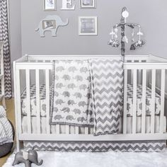 50 Adorable Decor Items For an Elephant-Themed Nursery Elephants have long been a source of inspiration for nursery themes and toddler room decor, whether the motif takes completely over or baby's room features one Elephant Baby Rooms, Elephant Themed Nursery, Baby Boy Rooms, Baby Boy Nurseries, Elephant Nursery Bedding, Chevron Nursery Boy, Small Baby Nursery, Neutral Nurseries, Toddler Room Decor