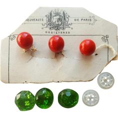 This listing is for 8 miniature, doll size buttons; From Paris, green glass and carved mother of pearl. All 8 buttons are pictured with details. There