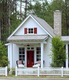 Tiny Romantic Cottage House Plan with comfortable outdoor seating and a small table. That red and white creates such a clean look. | Tiny Homes