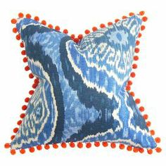 "Cotton pillow with a multicolor ikat and chevron motif and pom-pom trim. Made in the USA.    Product: PillowConstruction Material: Cotton cover and 95/5 down fillColor: MultiFeatures:   Hidden zipper closureMade in the USAInsert includedDifferent pattern on each side Dimensions: 18"" x 18""Cleaning and Care: Spot clean"