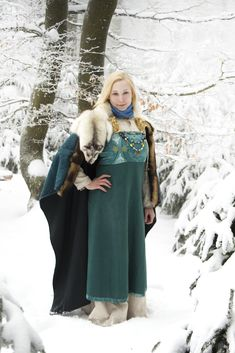 Viking outfit based on Birka finds made by www.wikinger-welten.de Underdress and Apron made from linen with block-printed silk trim. Woolen cloak with weasel fur keeps warm and comfy in winter.