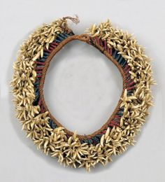 "Marquesas Islands | ""peue ei"" teeth and bead headband; The two interwoven strands of twisted coconut fibre suspending dense tassels of pierced porpoise teeth on strands of either six or seven blue or red beads 