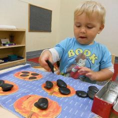 25 month-old Montessori toddler, actually counts as he places these rocks.