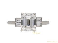 OnlineGalleries.com - Art Deco emerald-cut diamond flanked solitaire, English, circa 1930.