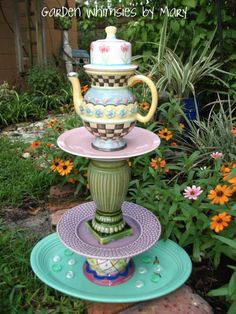 """My friend is making """"Garden Totems like this by recycling old china. Neat! can make into a bird feeder/ bird bath"""