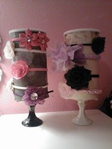 Headband holder made from oatmeal can, scrapbook paper and candlestick holder. Genius! Plus you can store other hair accessories in the can.