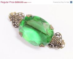 SaLe Antique Green Glass Large Rhinestone Filigree Czech Brooch by GrandVintageFinery on Etsy https://www.etsy.com/listing/200596016/sale-antique-green-glass-large