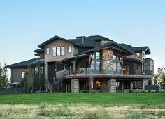<div><ul><li>A distinctive domed entry porch adds lots of flair to this Craftsman house plan.</li><li>The intricate roof lines and stone accents give you a unique home.</li><li>Step up from the entry foyer to a wide hall with double doors that open to the music room.</li><li>Beams top the dining room adding a rustic feel.</li><li>More beams can be found in the vaulted great room that has a big fireplace at o...