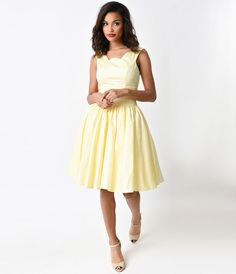 Prepare yourselves dames - a vintage vacation awaits! The soft yellow Roman Holiday from Unique Vintage is perfectly plucky in a timeless retro dress style, with a dainty scalloped neckline that extends around the V back, creating a delicate feminine décolletage. A day dress crafted in lightweight yet sturdy cotton fabric, with horizontal banding that minimizes the natural waist and enhances the grace of your curves. The tank style bodice works harmoniously with the gathered and tulle lined…