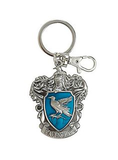 """<p>If the Sorting Hat places you in the Ravenclaw House, you were chosen for your wisdom, cleverness, and wit!</p>  <p>Silver tone metal key chain from <i>Harry Potter</i> features a die-cast Ravenclaw House crest design. Keyring includes attached lobster clasp.</p>  <ul> <li>3 3/4"""" long</li> <li>Alloy</li> <li>Imported</li> </ul>"""