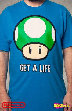 This Super Mario Bros. t-shirt features an image of a Mushroom, which could give a player an extra life in the classic video game, and the shirt reads Get A Life.