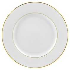 Featuring a crisp gold-hued rim for a touch of shimmer, this classic charger plate adds elegant appeal to your tablescape. Product: ...