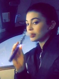 Kylie Jenner blowing O-rings from what resembled a vape.