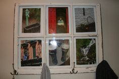 Old window to picture frame--->I picked up this old window at a flea market awhile back and finally decided what to do with it. I attached hooks from Home Depot and put in pictures from our trip to Ireland. Now it hangs next to the garage door for sweaters, coats and keys!