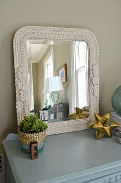 Cotton rope gets braided and woven to form an intricate and textural frame for a salvaged thrift store mirror.