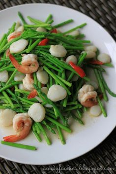 Chinese stir fried baby asparagus with scallops and king prawns