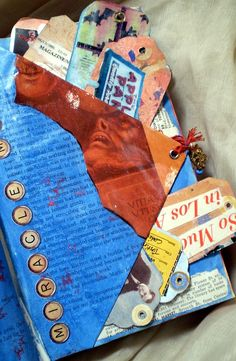 altered book   collage art   tag page