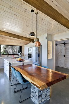 A hardwood slab extends from the kitchen bench in this Lockwood home Floating Fireplace, Kitchen Benches, Studio Room, Grand Designs, Dream House Plans, Australia Living, Home Reno, Maine House, Concrete Floors