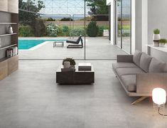 These popular cement effect tiles are available in a lovely grey matt finish, that uses a subtle mottled finish to provide that perfect contemporary look.Free samples available Patio Tiles, Concrete Tiles, Cement, Grey Floor Tiles, Grey Flooring, Beach Patio, Open Space Living, Style Tile, Gray