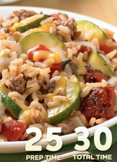Added a packet of taco seasoning and used regular diced tomatoes and frozen corn. My kids loved it! It doesn't get much better than this Zucchini-Beef-Rice Skillet recipe—ready for dinner in just 30 minutes! Beef Recipes, Cooking Recipes, Healthy Recipes, Beef Meals, Hamburger Recipes, Skillet Recipes, Top Recipes, Freezer Meals, Beef Dishes