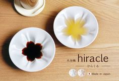 Beautiful sauce dishes, combining art with utility! The liquid makes a little Sakura (cherry blossom).