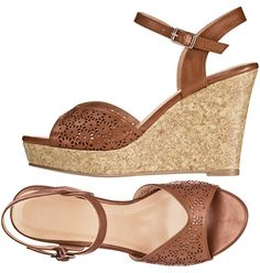 """Chic Cutout Wedge- A faux-cork wedge goes with everything! Leatherlike upper with adjustable-buckle ankle strap. Cork-look wedge with 3/4"""" platform and 3 3/4"""" H heel. Shop online at www.youravon.com/tashina"""
