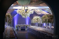 Four thousand Candles, mass arrangements, white roses, hydrangeas, orchids big floral arch. White Roses Wedding, Floral Arch, Event Company, Orchids, Wedding Planner, Floral Design, Ceiling Lights, Candles, Table Decorations