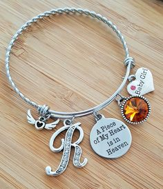DiamondJewelryNY Eye Hook Bangle Bracelet with a St Kevin Charm.