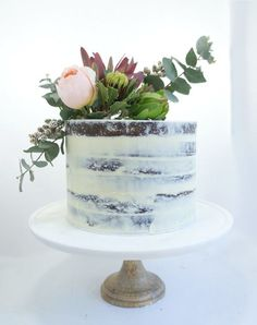 The semi-naked cake trend is perfect for the rustic, outdoorsy vibe of a desert-themed wedding. The subdued color palette, natural arrangement of fresh flowers and succulents are all perfectly placed.