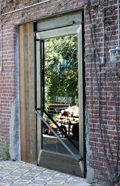 great door contrast of metal, wood, & glass