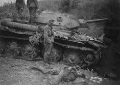 Knocked out T-34 tank and dead crew in the foreground observed by German mountain troops NCO. The engagement took place new Panteleyev Balka in the Ukraine on May 27, 1942.
