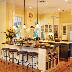 kitchen ~ soft yellow paint ~ white cabinets ~ dark wood for island, breakfast nook table
