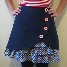 This darlin little number is made from vintage, navy blue wool. Blue cotton ruffles peek out from underneath, printed with white circles and red