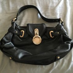 Black leather handbag Laundry by Shelli Segal black leather handbag. Chunky, gold hardware is sturdy but not as clean and shiny as it once was (visible in photo and reflected in price). Leather is clean and lining is perfect. Laundry by Shelli Segal Bags Satchels
