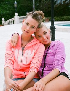 Behati and Elsa heart PINK's spring hoodies.