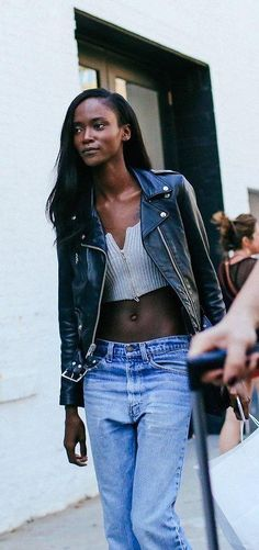 High waisted vintage denim, zipped crop top and leather jacket