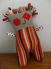 * Taggy toy. Ribbon and polar fleece scraps.