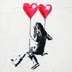 Banksy artwork depicting a girl swinging with two heart shaped helium balloons a. Banksy artwork depicting a girl swinging with two heart shaped helium balloons above The Bristol Fine Art Shop, Bris Banksy Graffiti, Street Art Banksy, Banksy Girl, Banksy Artwork, Bansky, Graffiti Wall, Banksy Paintings, Banksy Prints, Berlin Graffiti