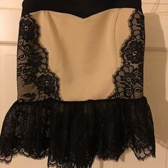 Love culture lace bottom strapless peplum! Absolutely gorgeous lace detail. Peplum is slightly see through at lace part. Never been worn out only tried on. In perfect condition! Love Culture Tops
